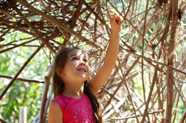 Young girl inside the willow house