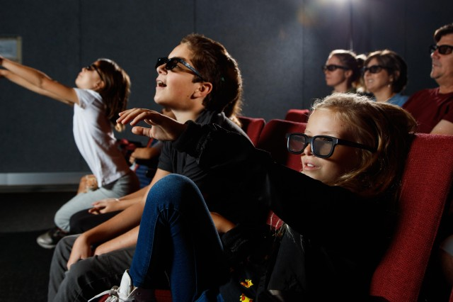 kids and adults in 3D theater with 3D glasses