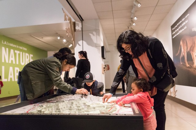Mother and daughter looking at topographic map in P-22 exhibition