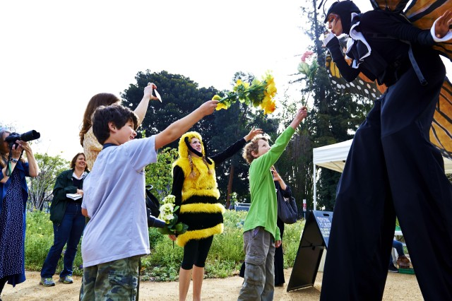 Educators in a bee and butterfly costume entertain kids at Nature Fest