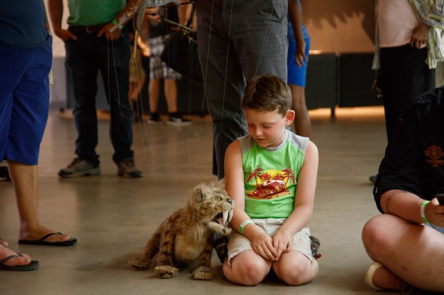 Nibbles, the small Saber-Toothed Cat puppet, at a Tar Pits Live Theater show