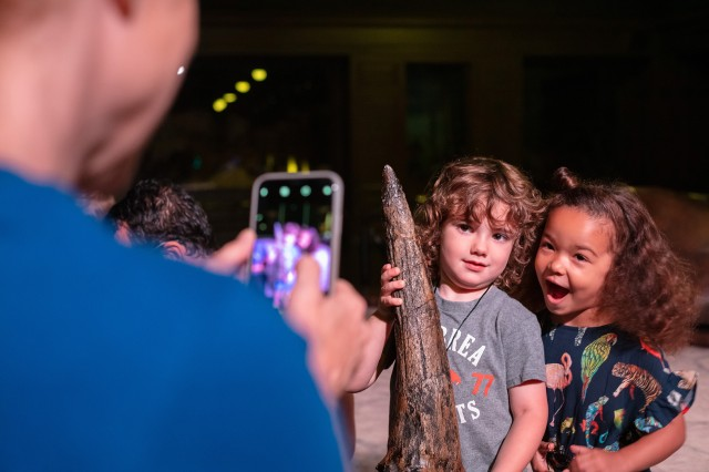 Kids posing for a photo during Dinosaur Encounters show