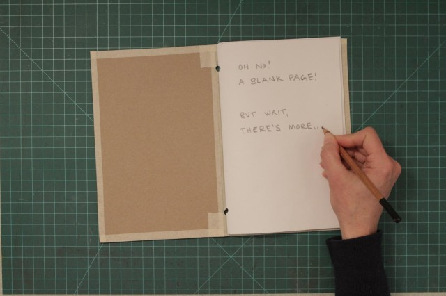 "Showing a first page of the book that looks blank but says ""but wait, there is more!"""