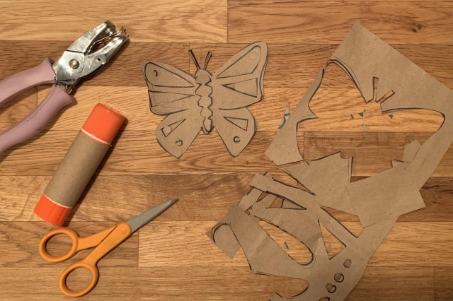 Cut out butterfly shapes from the heavyweight paper