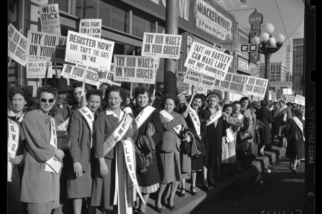 black and white photo of women holding signs