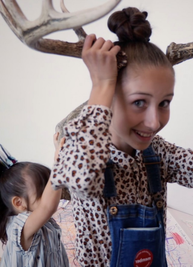Girl playing with horns in Discovery Center