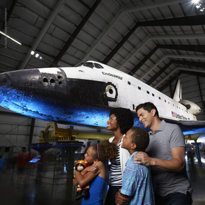 science center guests in front of space shuttle endeavor