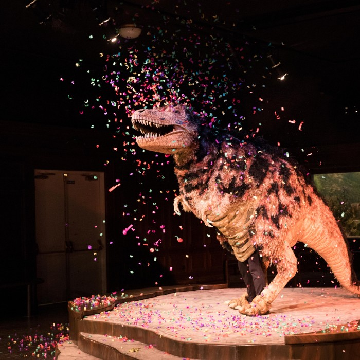 Hunter the T Rex covered in confetti during a Dinosaur Encounters Show at Dino Fest