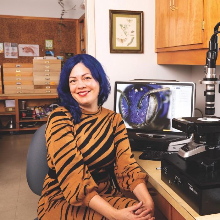 Lisa Gonzalez at her microscope