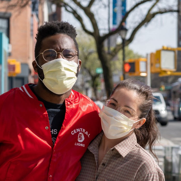 young couple outside wearing face masks
