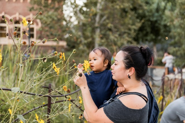 mother and child with flowers in nature gardens
