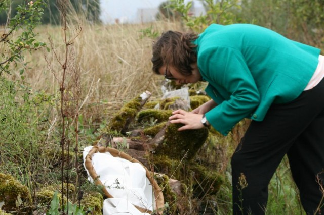 Emily Hartop studying flies on a mossy rock