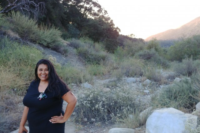 Brenda Kyle stands in the dry creek bed at Eaton Canyon