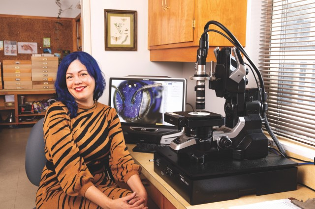 Lisa Gonzalez at her microscope