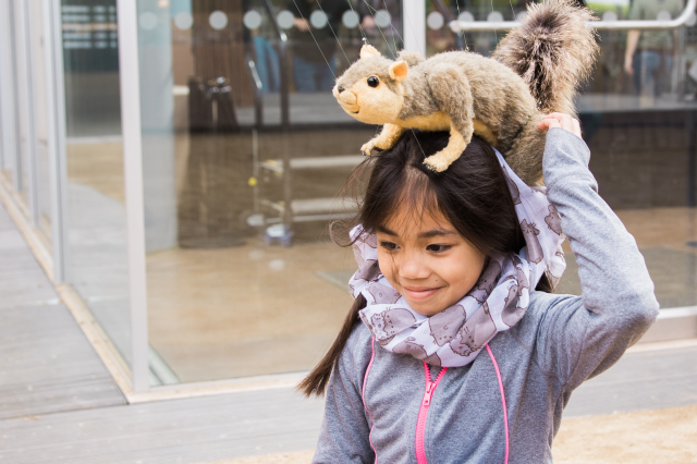 squirrel on girl's head