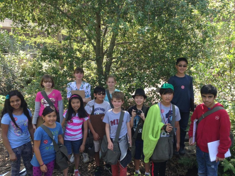 Nature Navigators 2015 class posing for a photo after checking their camera trap in NHM Nature Gardens.