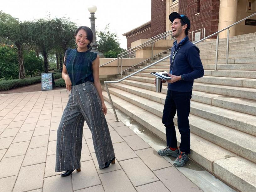 Jane striking a pose, Richard laughing outside NHM