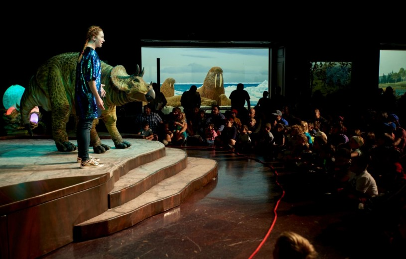 Students watch our Dinosaur Encounters show, with our life-sized juvenile Triceratops.
