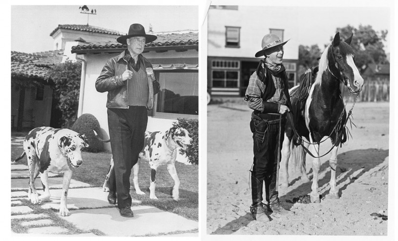William S. Hart with his dogs and his horse
