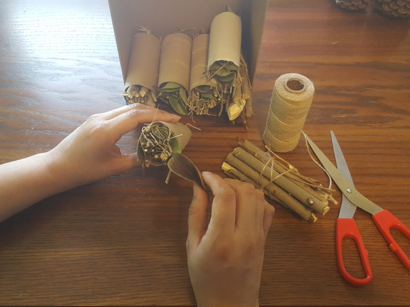 Bug Hotels step 2 - fill toilet paper rolls with leaves and sticks, or tie bundles of sticks together tightly