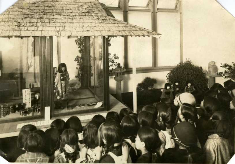 Japanese children attending a departure ceremony for the Japanese Friendship Doll