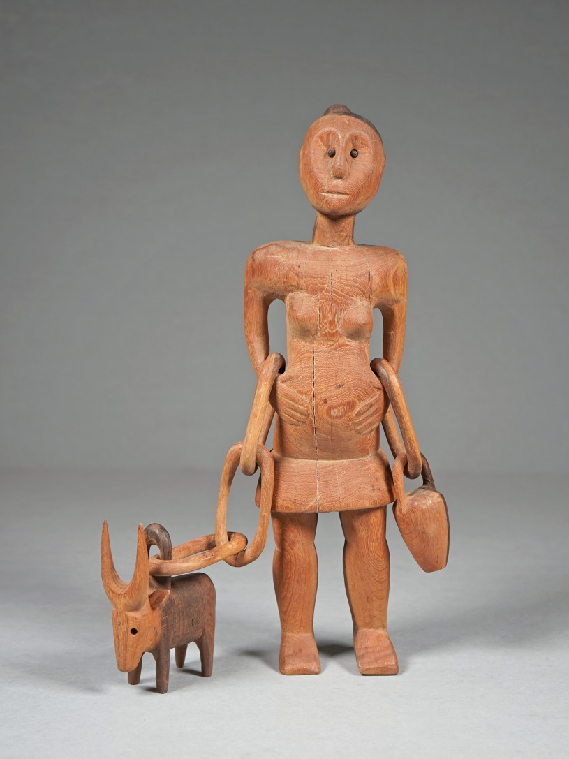 Woman with Ox Figurine