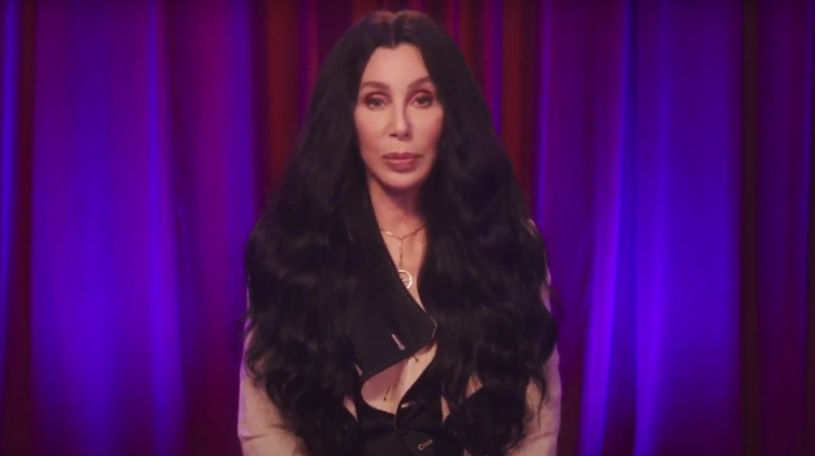 Cher with draped backdrop