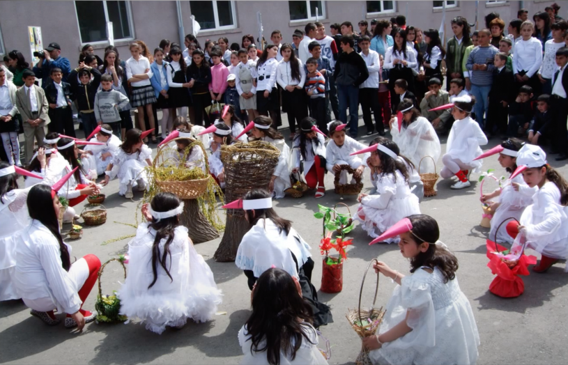 Children dressed in white stork costumes