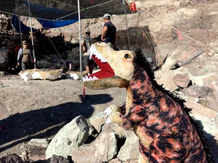 Hunter, the T. Rex Plushie at an dinosaur dig in utah