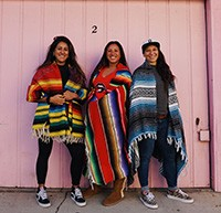 Courage Camps founders standing together wrapped in Mexican blankets (resized for website)