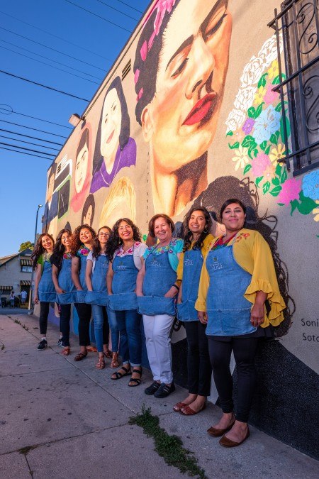 Todo Verde Team Stands by Mural