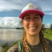 Melissa Sanchez standing next to lake